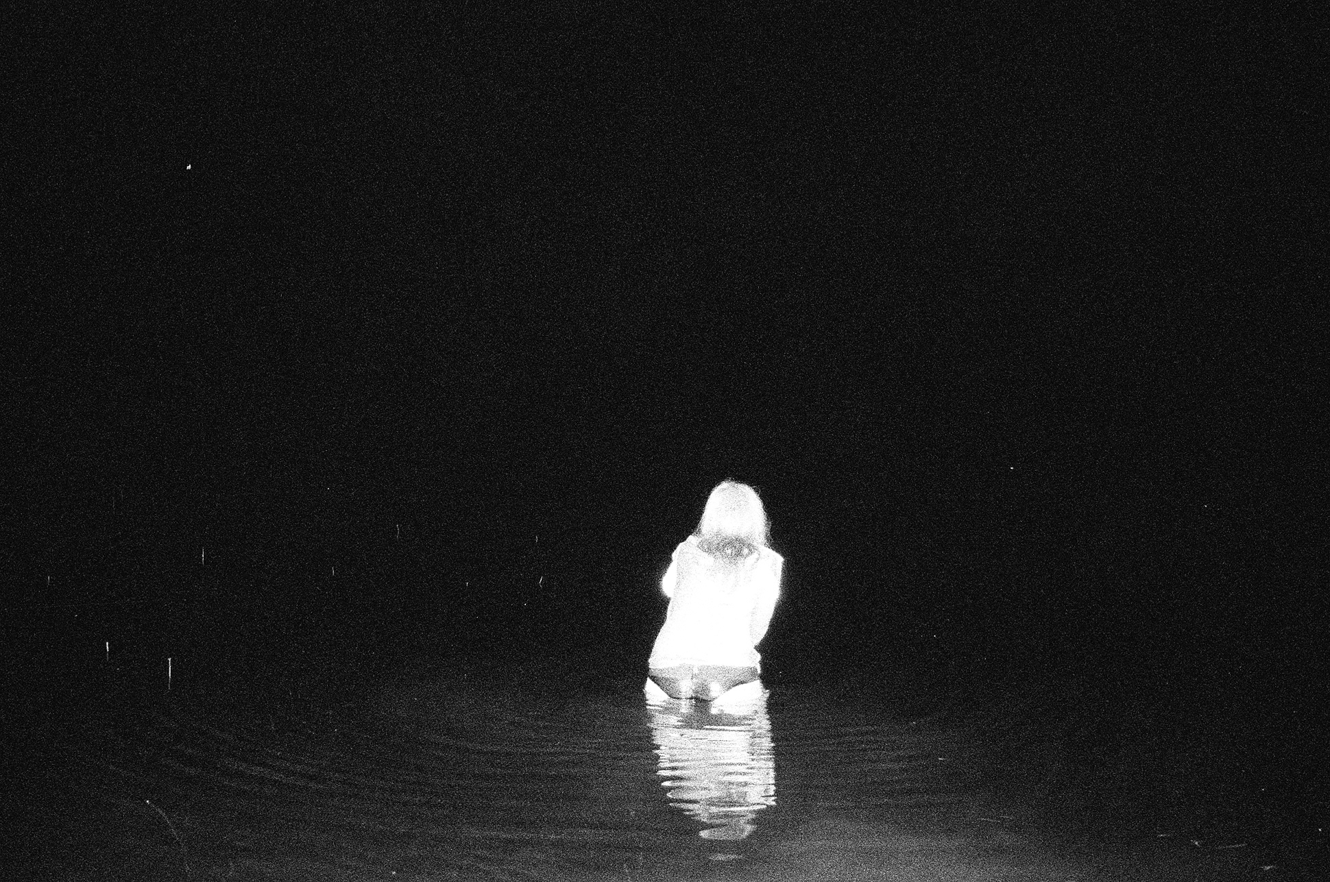 """""""a black and white photo of a woman standing in the sea from Lina Scheynius photo-essay for Tabayer jewelry Tabayer jewellery"""""""